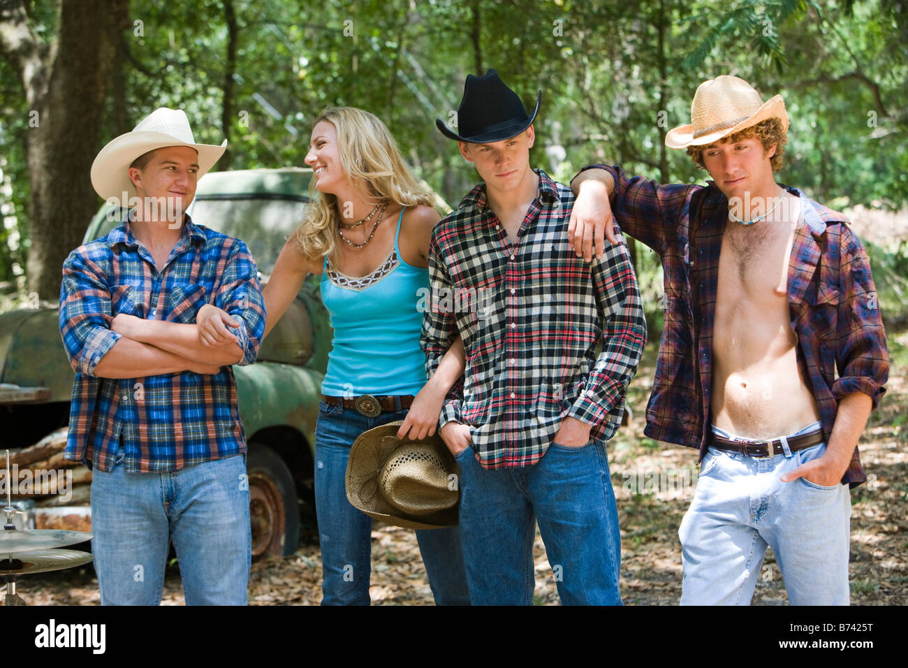 Young Men Wearing Cowboy Hats Chatting With Pretty Blonde
