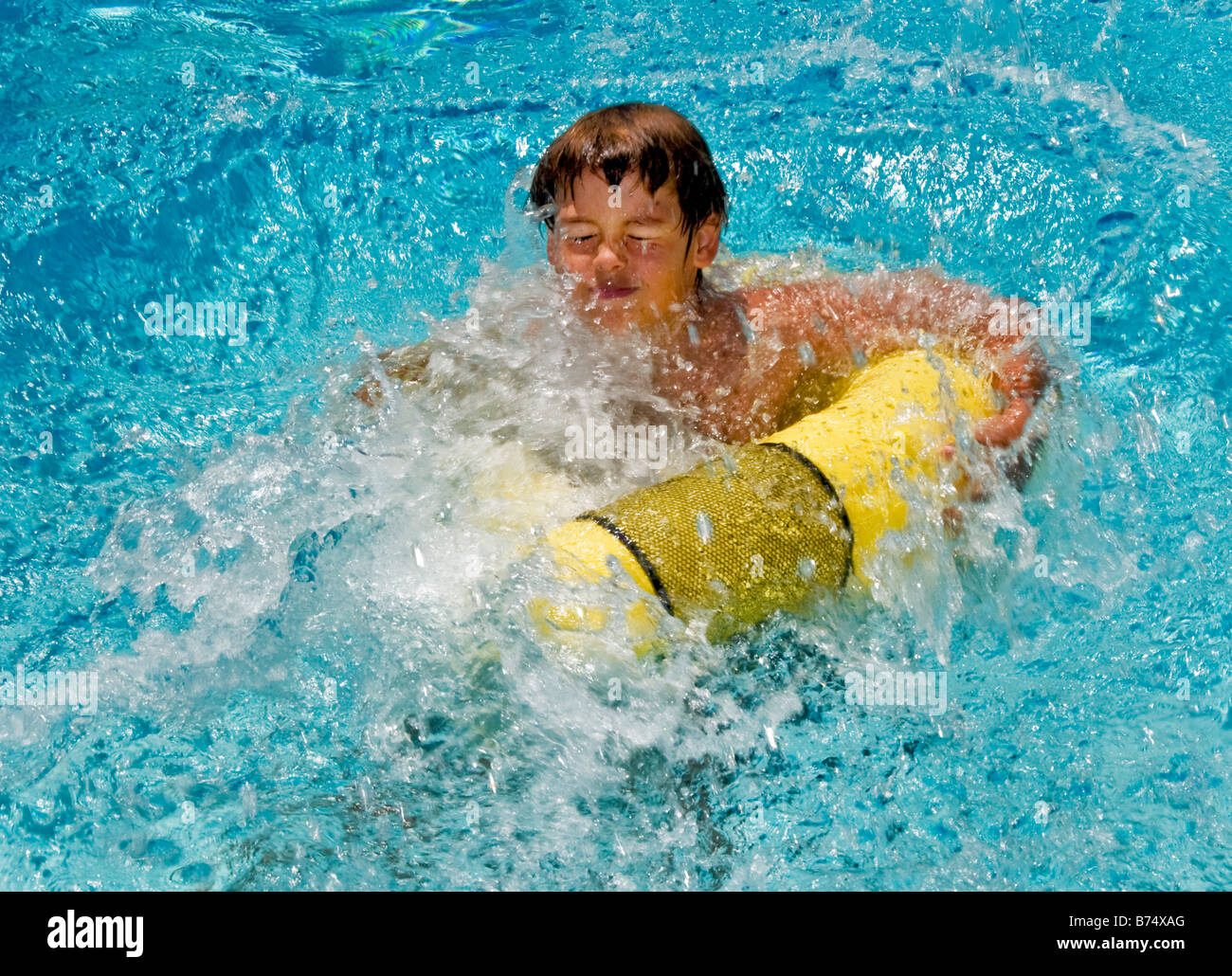 Grimacing A 10 Year Old Boy Splashes Into A Swimming Pool In Laguna Stock Photo Royalty Free