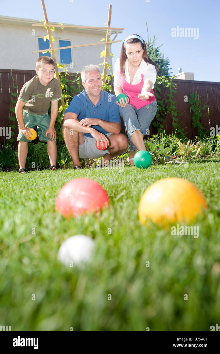 family play bocce ball in backyard winnipeg manitoba canada