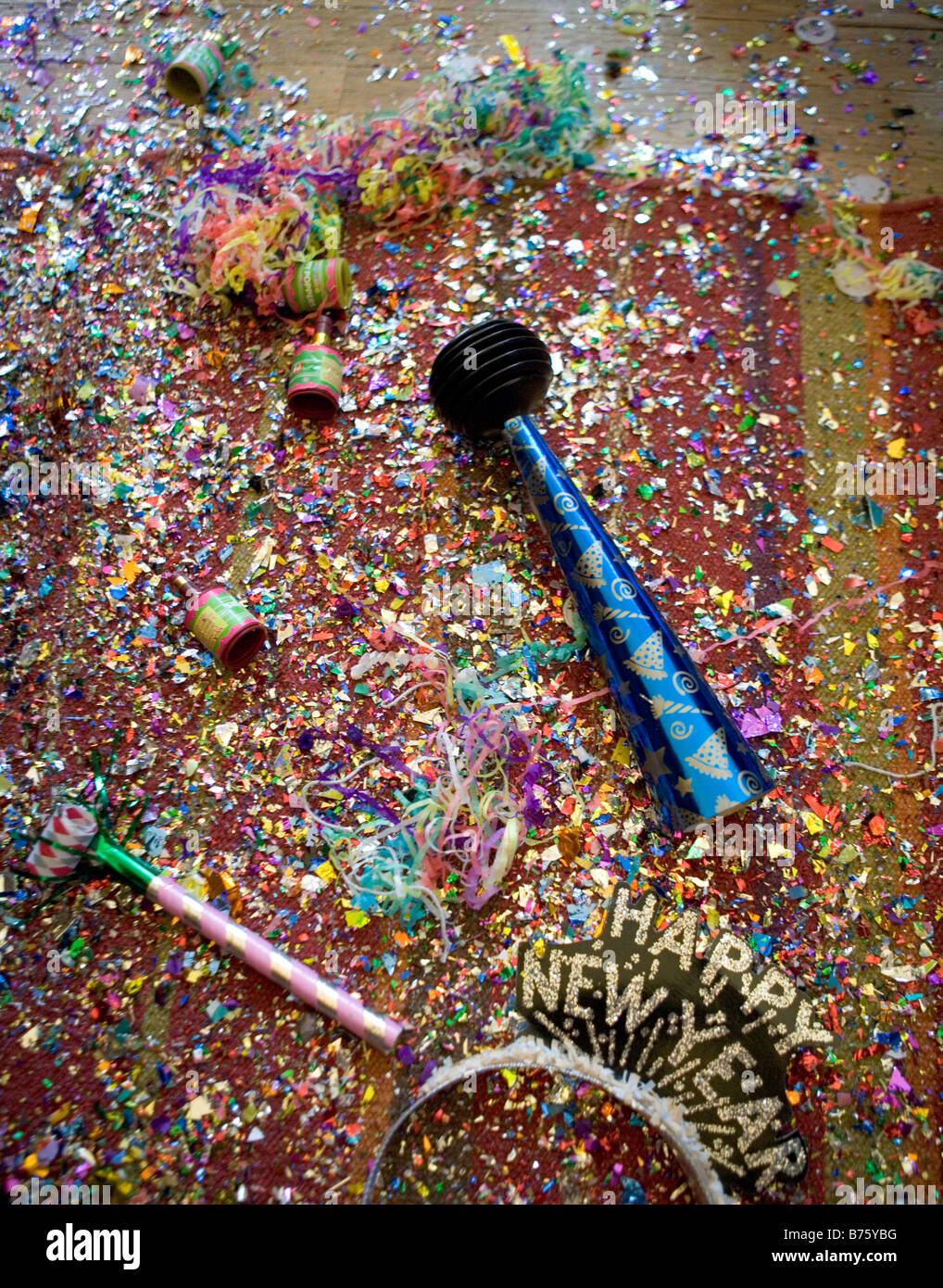 new years eve party wreckage including confetti poppers horns streamers and hats