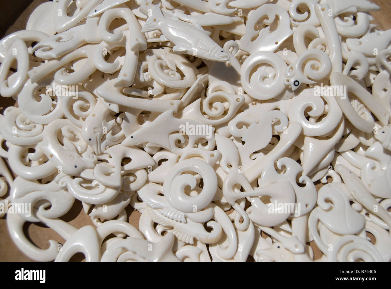 Bone carving pendants in the traditional forms of maori