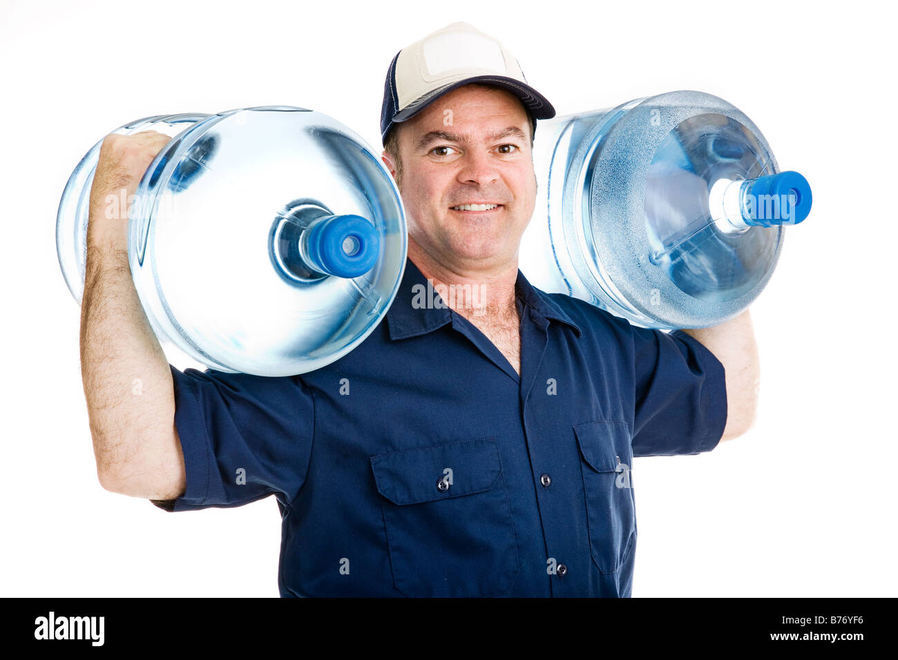Man drinking water bottle office stock photos man drinking water strong water delivery man smiling as he carries two full five gallon water jugs on his sciox Gallery