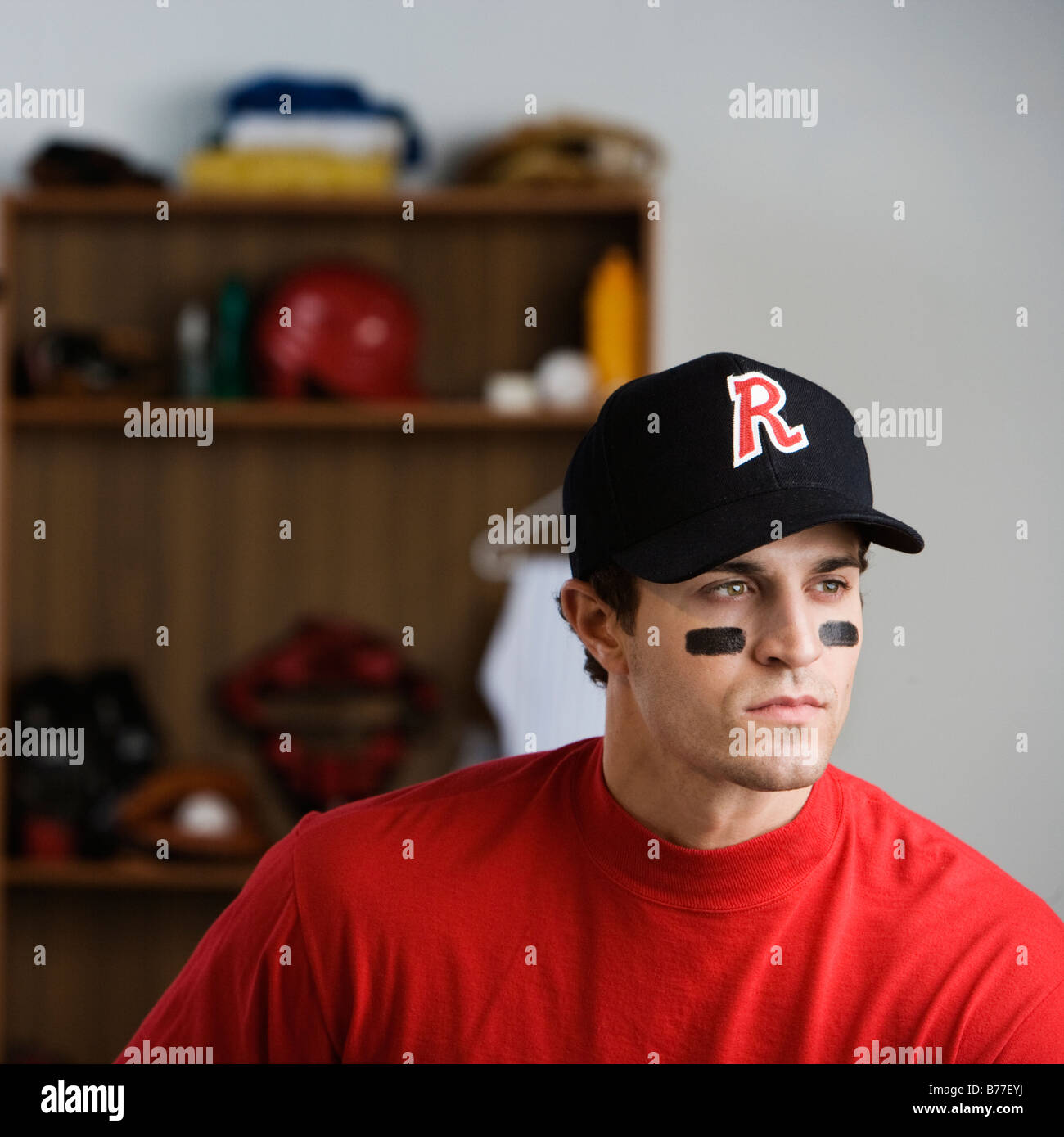 Baseball Player Looking Pensive Locker Room