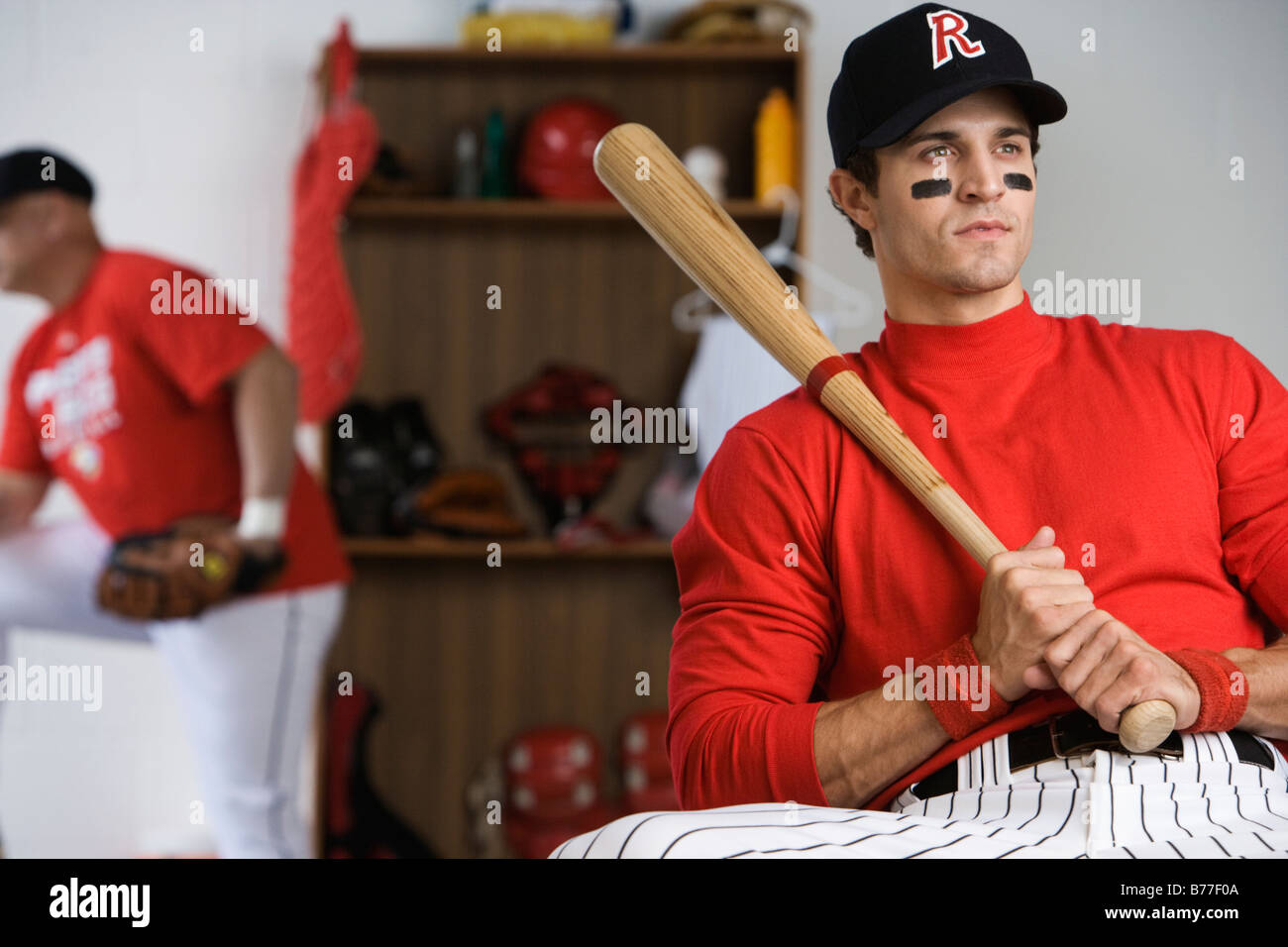 Baseball Player Holding Bat Locker Room