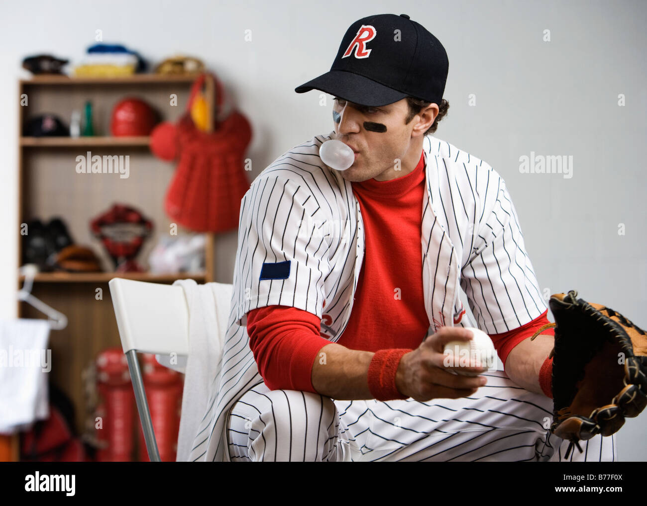 Baseball Player Blowing Bubble Gum Locker Room