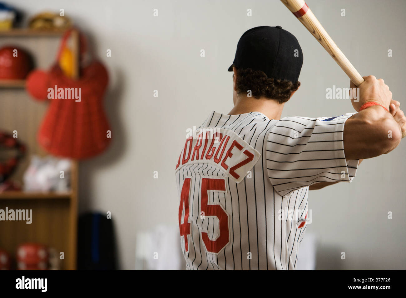 Baseball Player Practicing Swing Locker Room