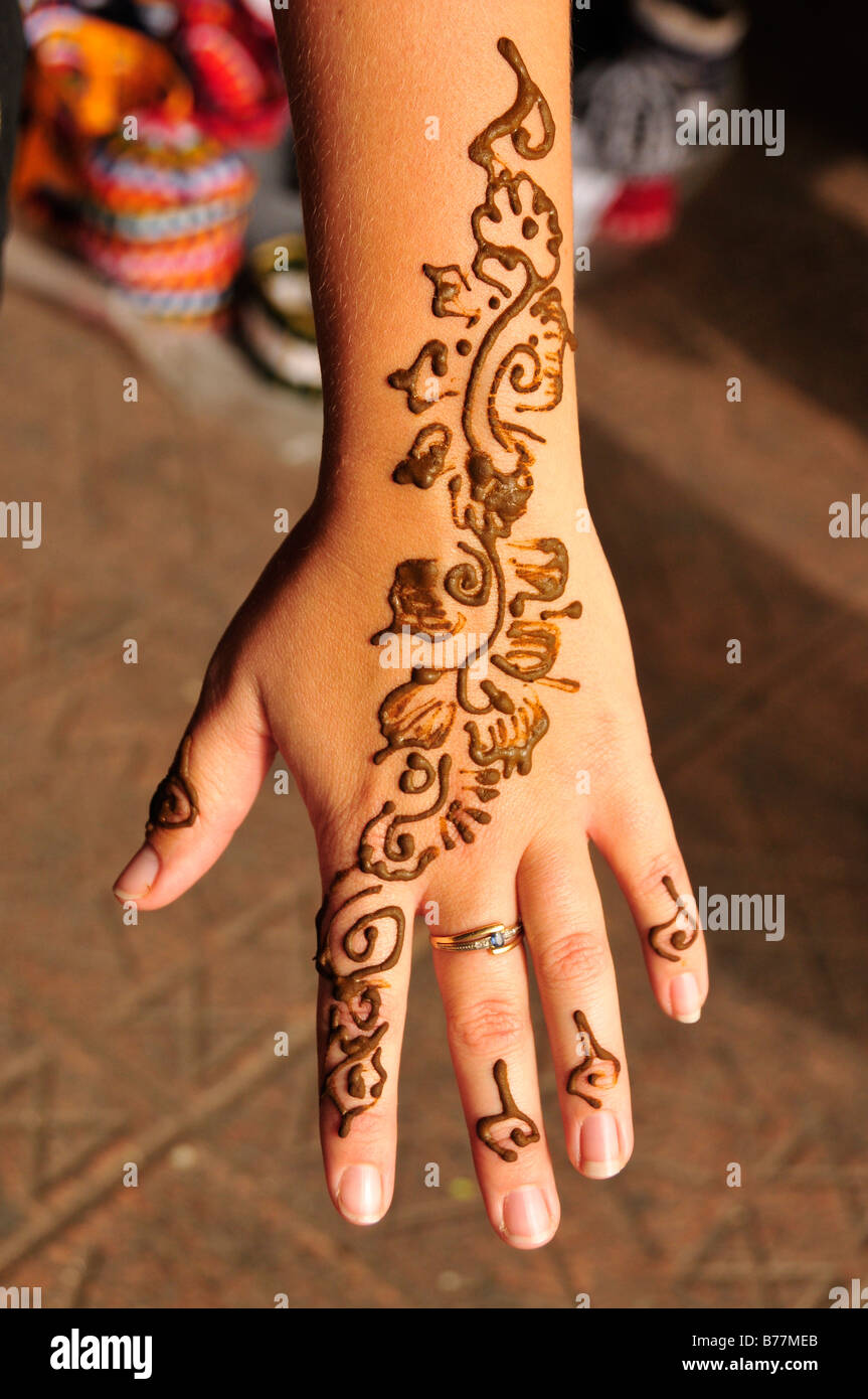 henna tattoo on the hand of a tourist place djemma el fna. Black Bedroom Furniture Sets. Home Design Ideas