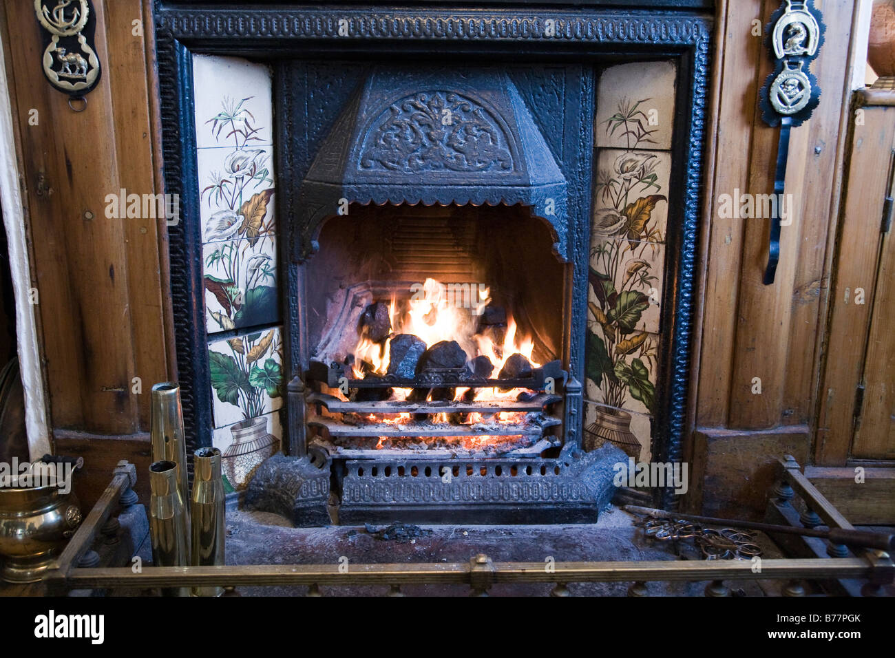 open traditional coal fire with horse brasses in a pub stock photo