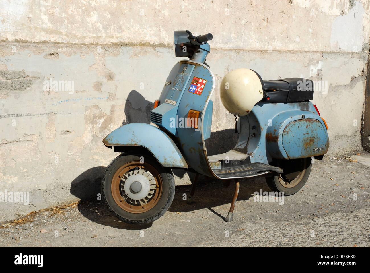 blue piaggio vespa motor scooter on stromboli island, aeolian or