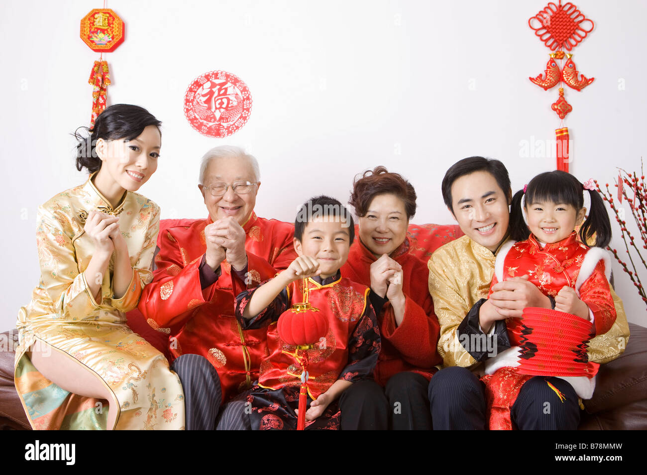 family members in traditional clothes celebrating chinese new year stock photo royalty free. Black Bedroom Furniture Sets. Home Design Ideas