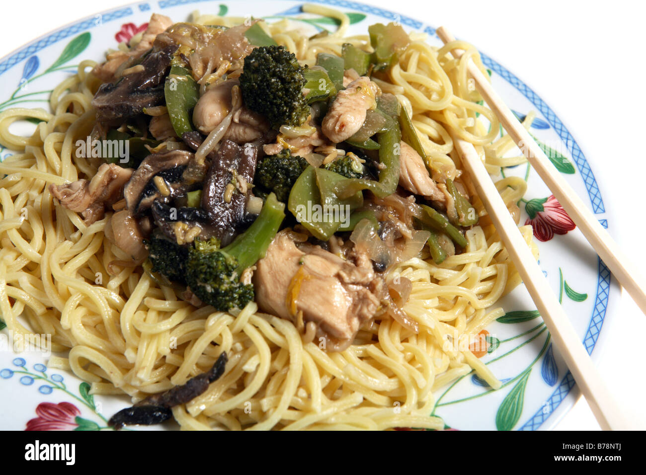 A Plate Of Chicken Chow Mein Cantonese Egg Noodles With Chopsticks