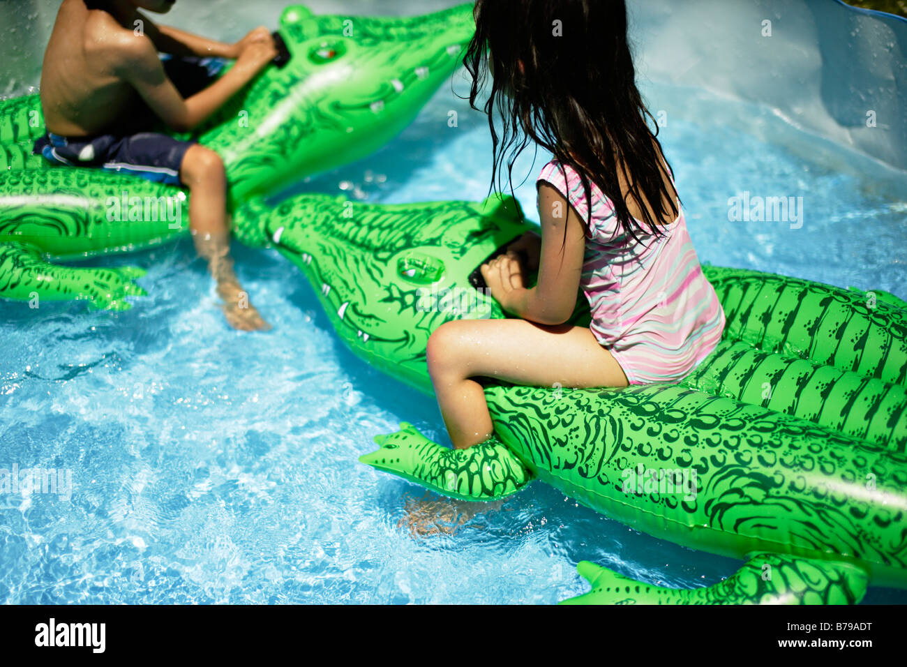 Children Ride Inflatable Crocodile In Paddling Pool