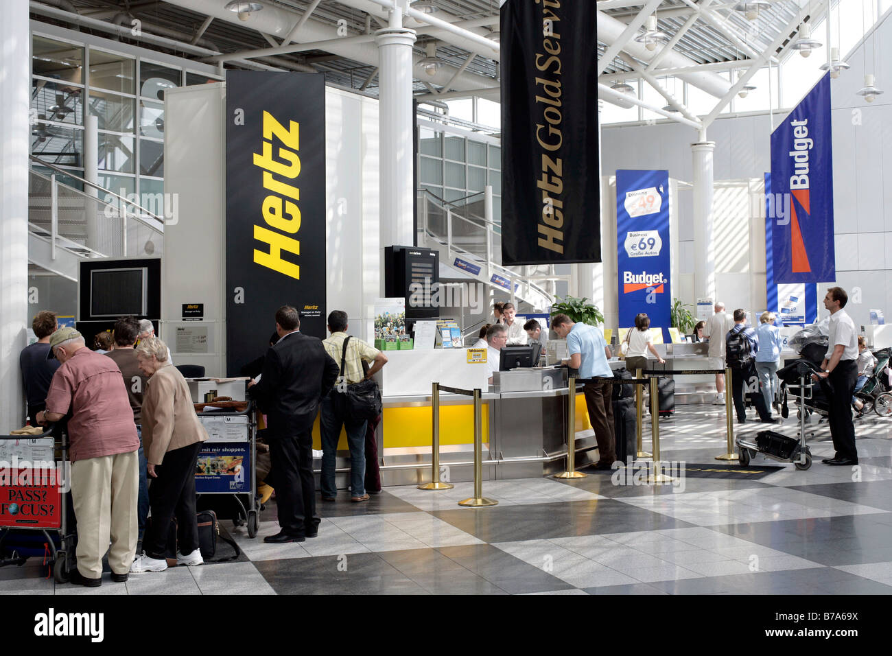 Car rental desks of the hertz and budget car rental companies in the munich airport bavaria germany europe