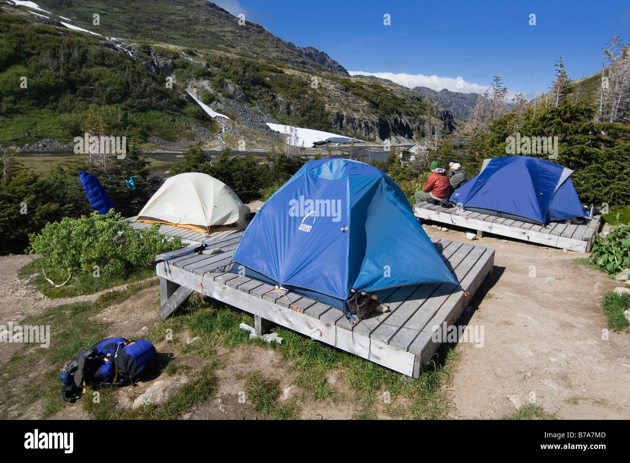 Tents on wooden platforms happy camp camp ground at the for Tent platform design