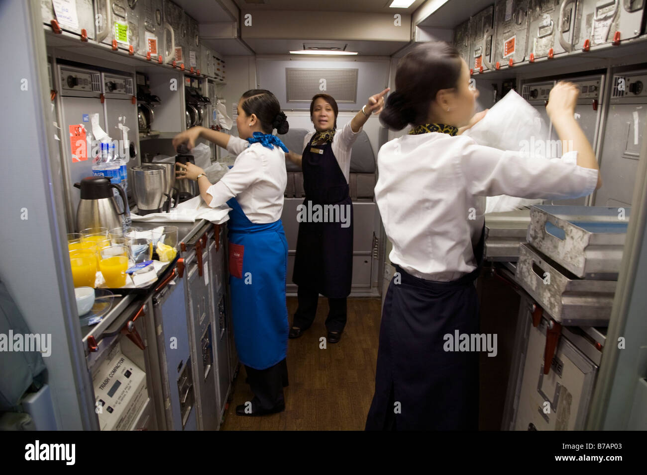 Cabin Crew Preparing Meals In The Galley On A Gulf Air