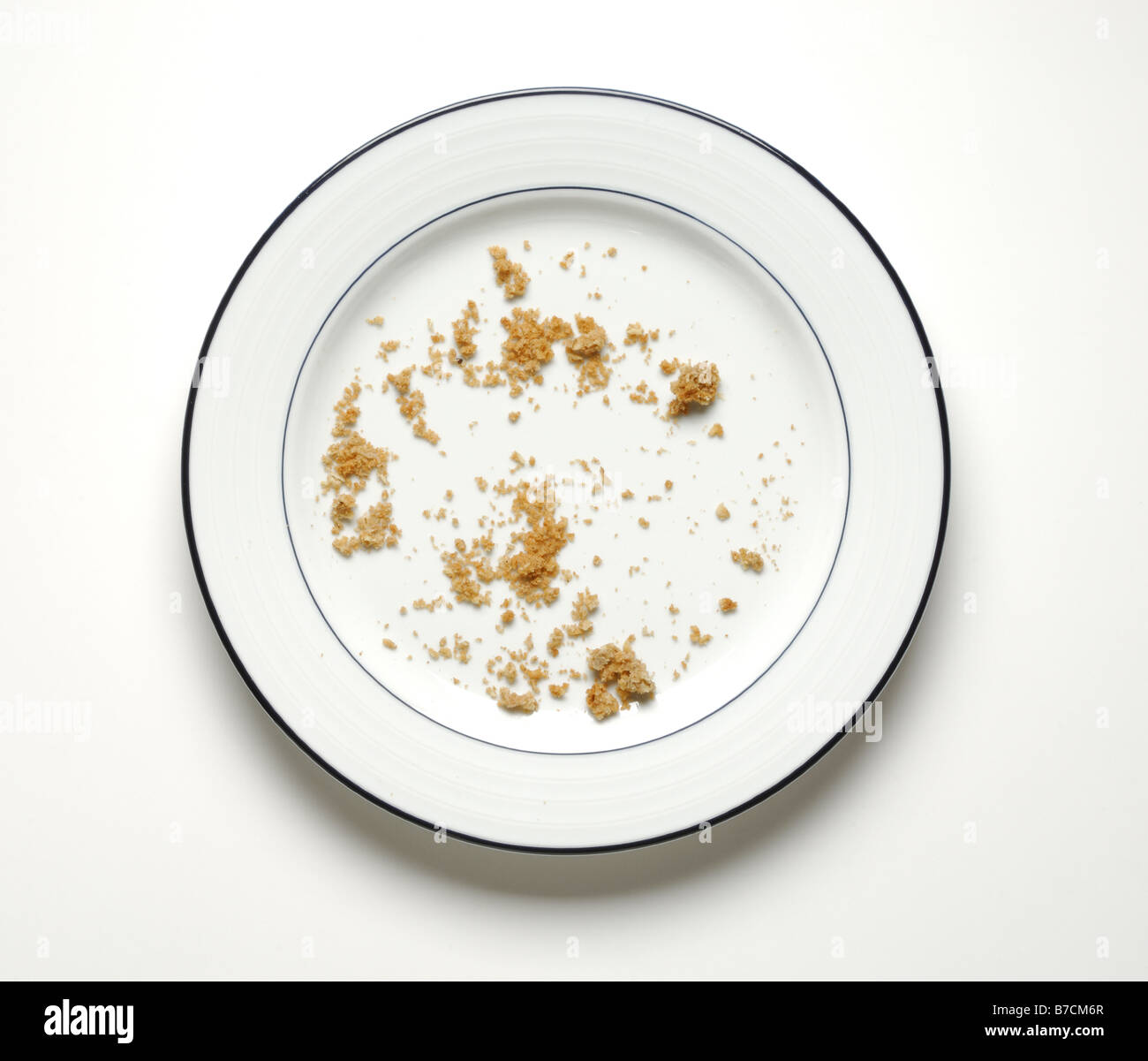 Crumbs Of Food On A Round Dinner Plate Stock Photo