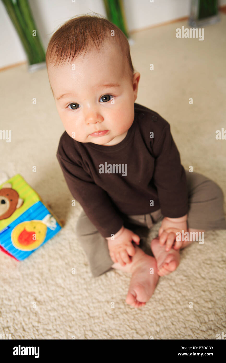 Toys For 4 Month Old Baby : Baby month old with bare feet sitting on a carpet toys