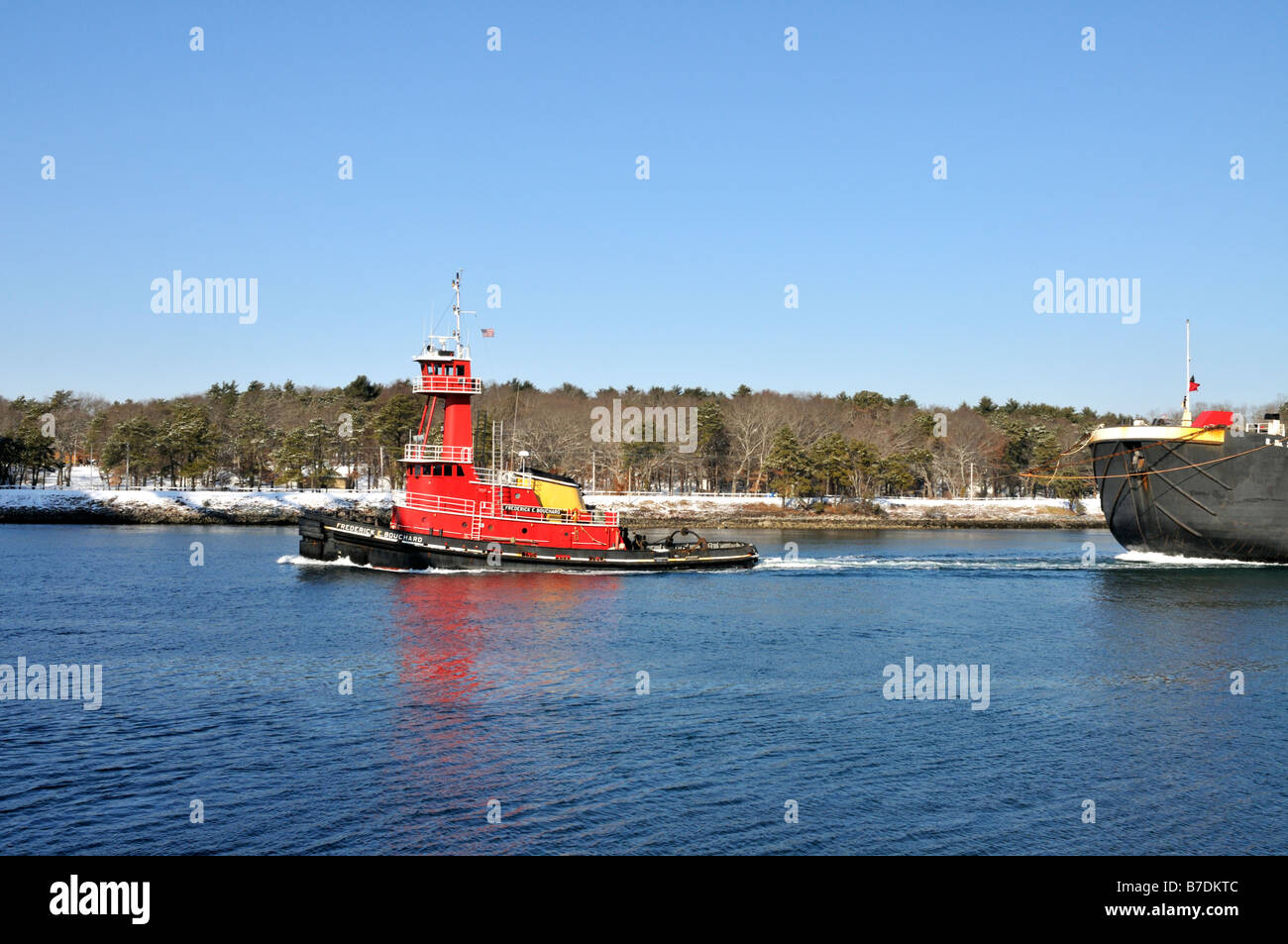 Red tugboat pulling double hull fuel oil barge through cape cod red tugboat pulling double hull fuel oil barge through cape cod canal from bouchard transportation company nvjuhfo Choice Image