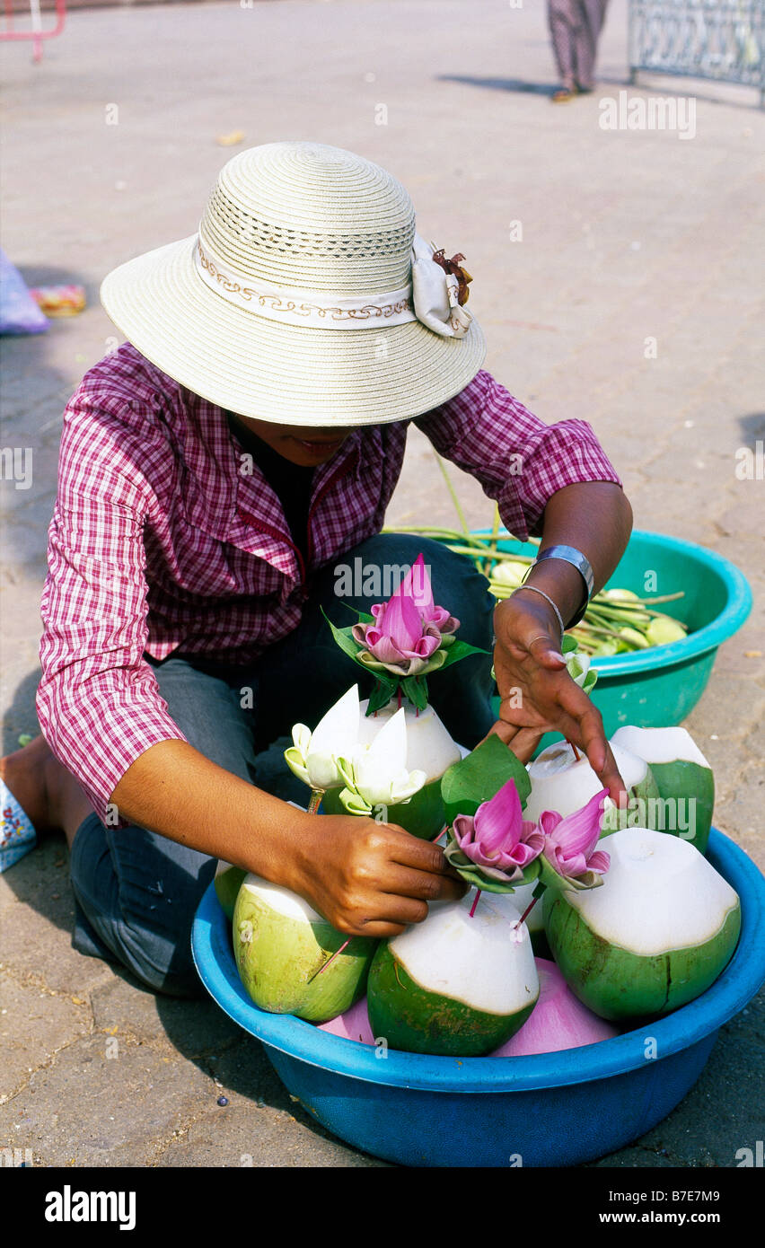 Stock Photo   Street Woman Making Green Coconut And Lotus Flower  Arrangements For Sale PHNOM PENH CAMBODIA Part 64