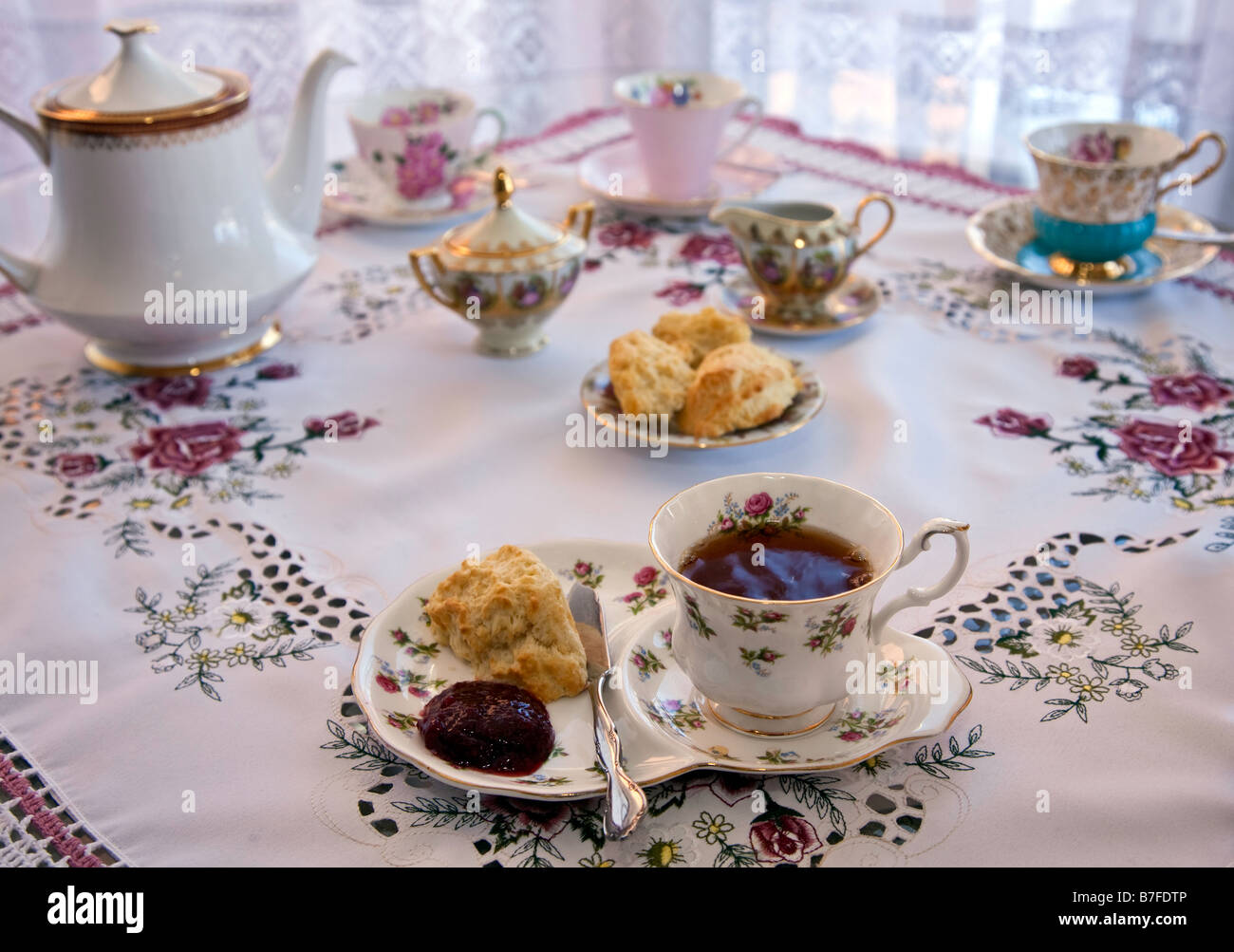 Traditional English High Tea with Tea Biscuit Table setting In
