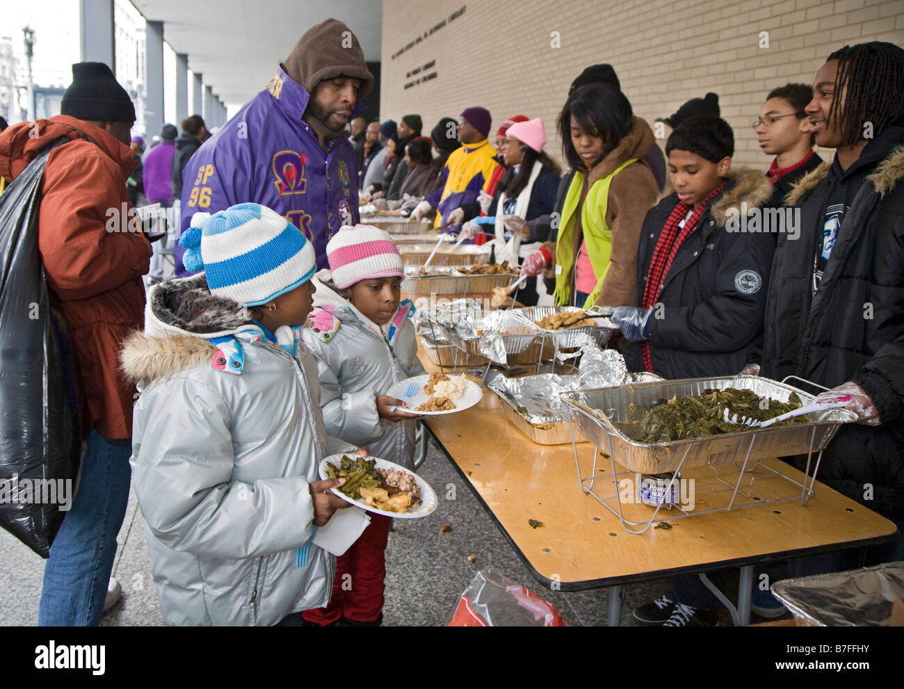 Soup Kitchen Volunteers Serve Meal To The Homeless At Outdoor Soup Kitchen