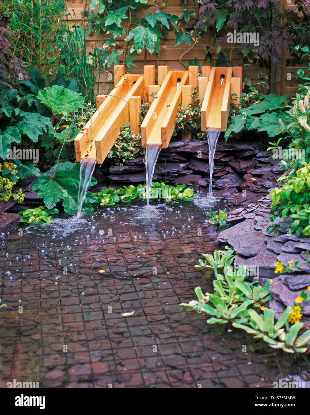 Stock photo water fall in water feature using wooden troughs