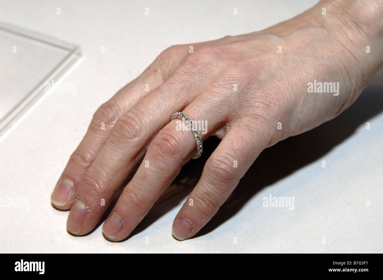 Woman displays costume jewelry wedding ring in the newly overhauled