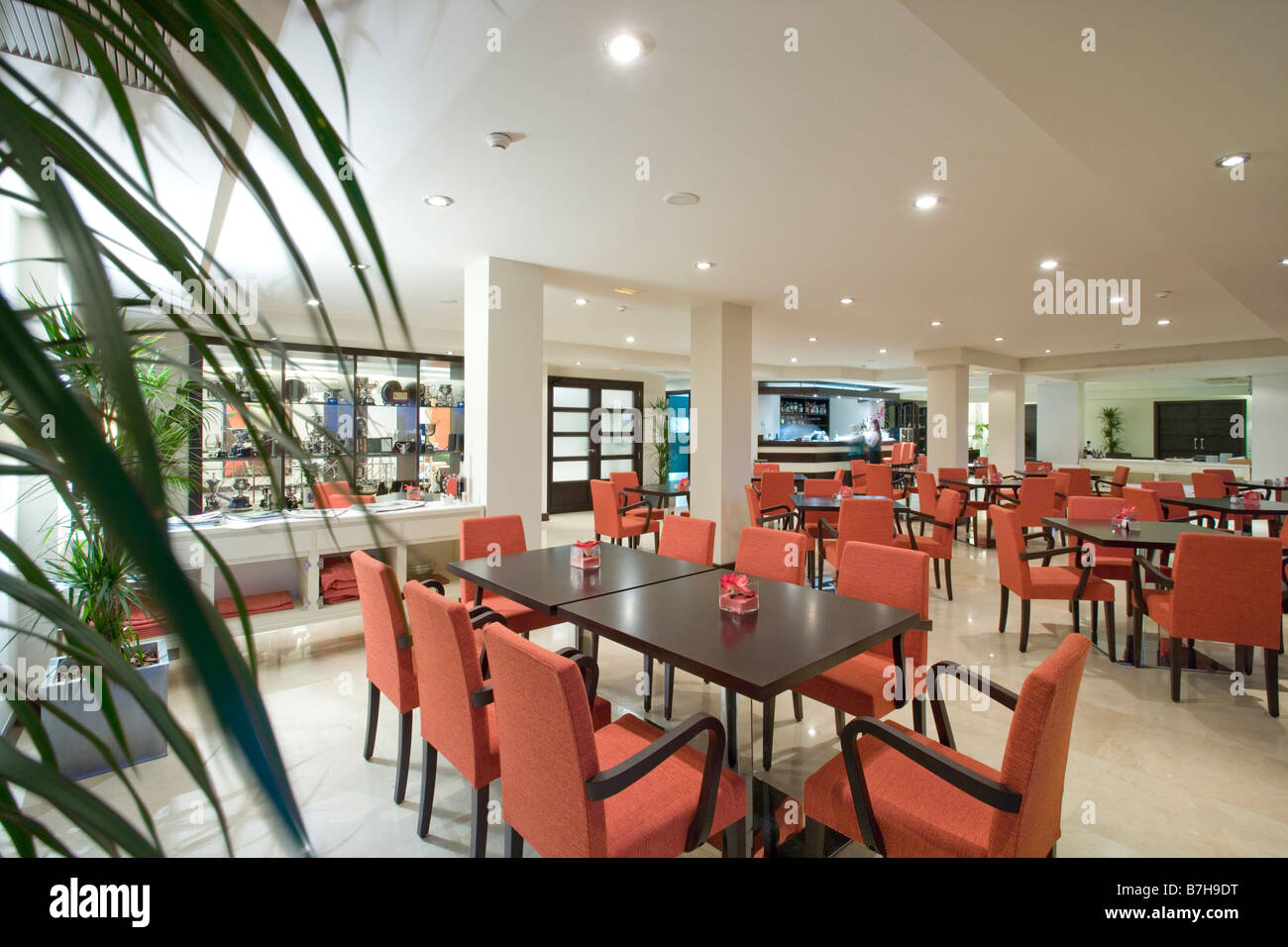 Red chairs and black tables in modern restaurant at the Mclundie ...