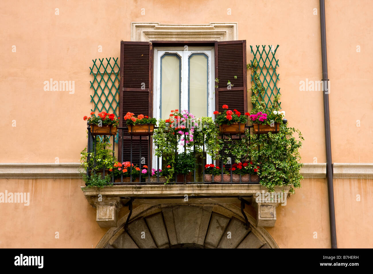 Flowers on window balcony in rome italy stock photo for Balcony in italian