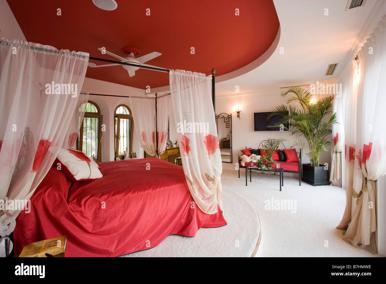 Bedroom ceiling drapes - Red Ceiling Above Bed With White Voile Drapes And Red Bedlinen In Bedroom With White Carpet
