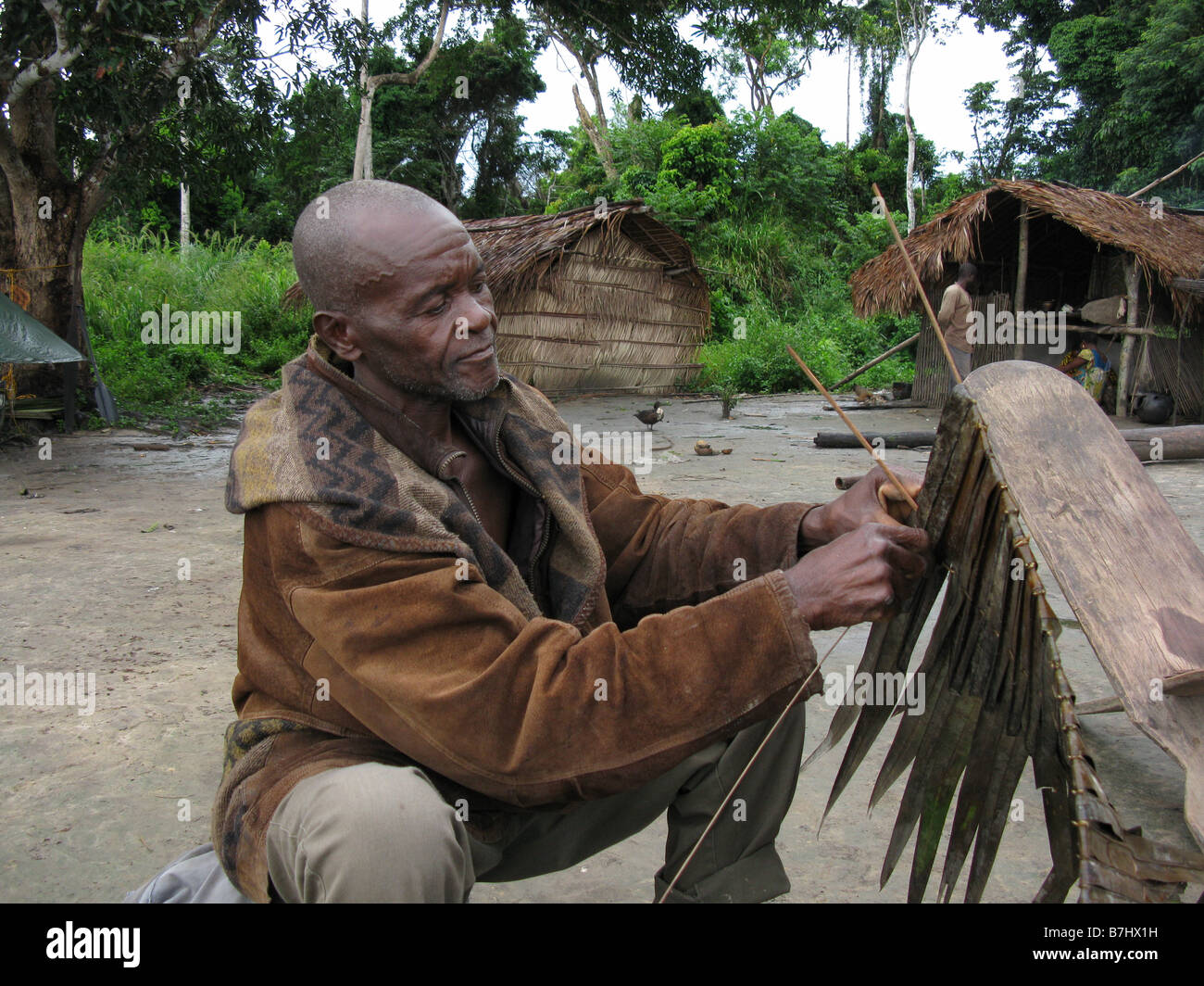 Headman of tiny village weaving waterproof roofing from jungle grasses on Sumba Island Democratic Republic of & Headman of tiny village weaving waterproof roofing from jungle ... memphite.com