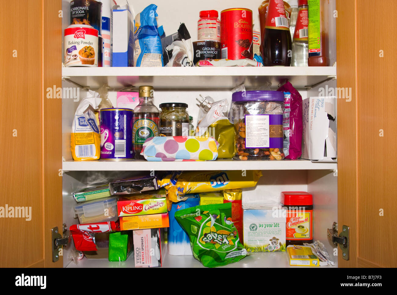 Stock Photo   Open Kitchen Cupboard Cupboards Containing Food Foodstuffs