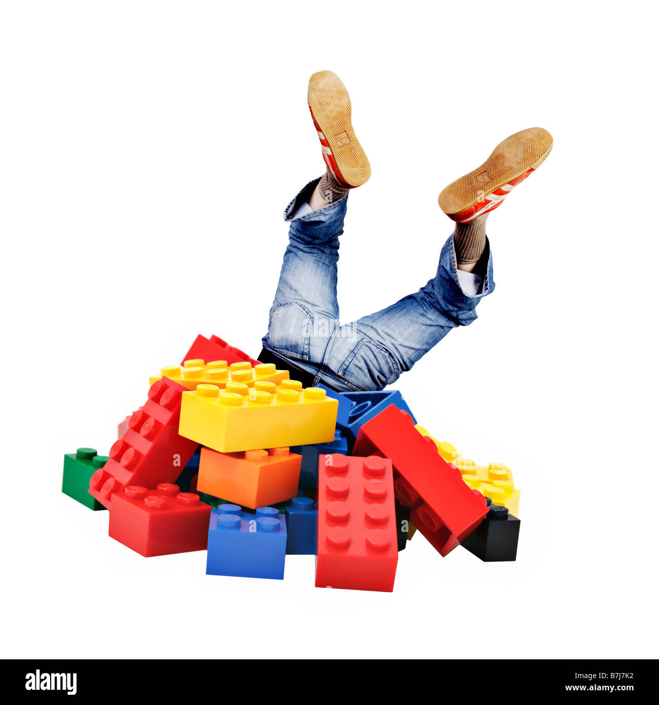 Person Head First In A Pile Of Lego Bricks