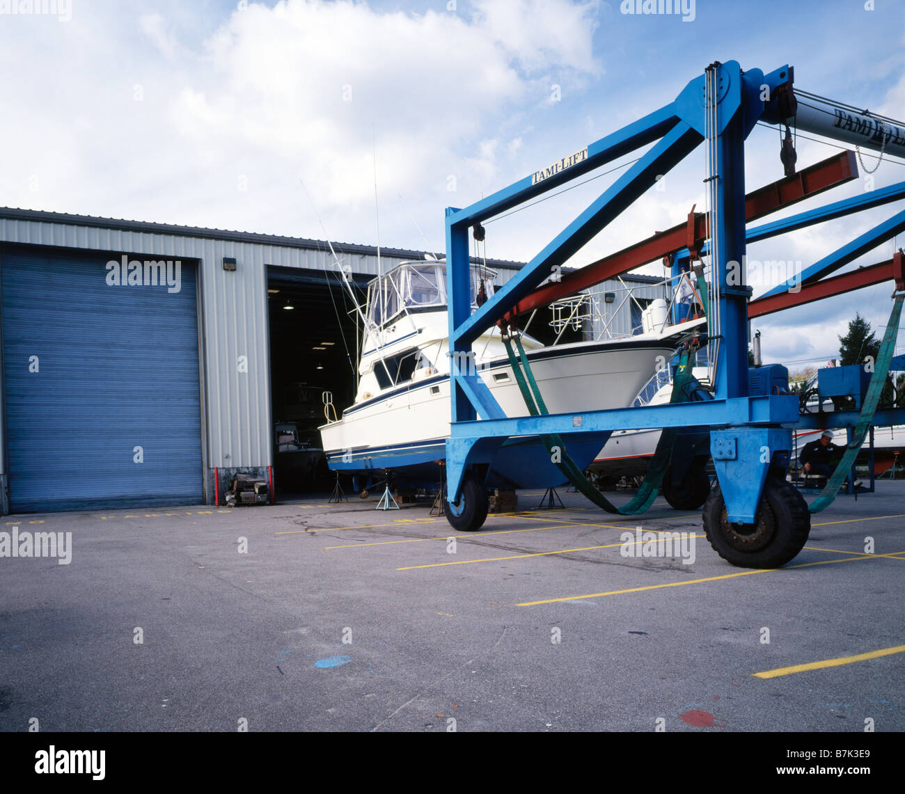 Tami lift hoist for hauling and moving boats at marinas for Boat garage on water
