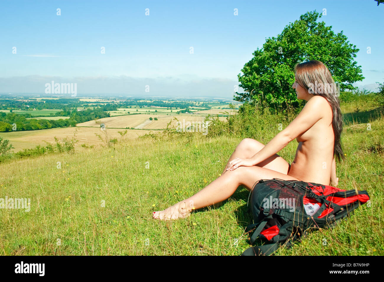side view of naked female naturist rambler enjoying the british stock