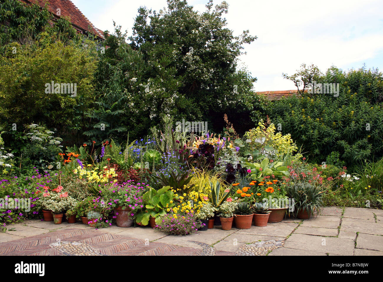 Colourful Summer Pot Plants Add To A Paved Area Within An