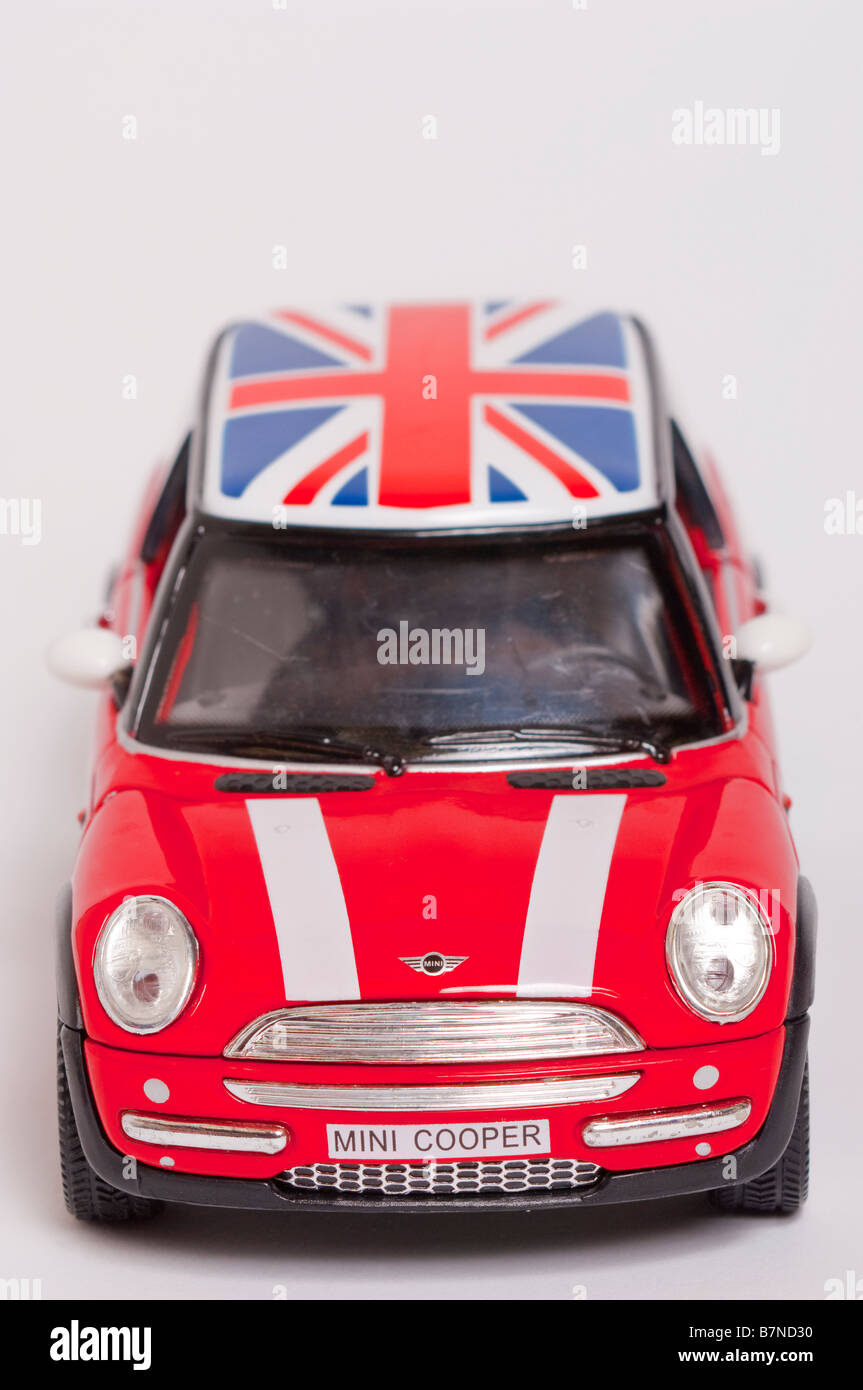 A close up of a toy model mini cooper car on a white background stock