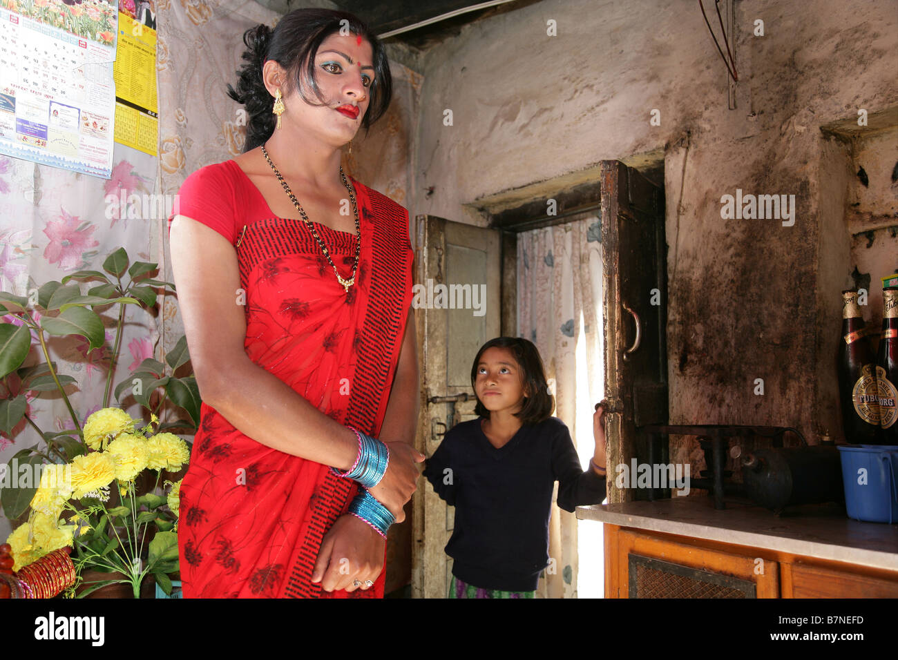 indian ladyboy Ladyboy Garema getting a strange look from a small girl - Stock Image