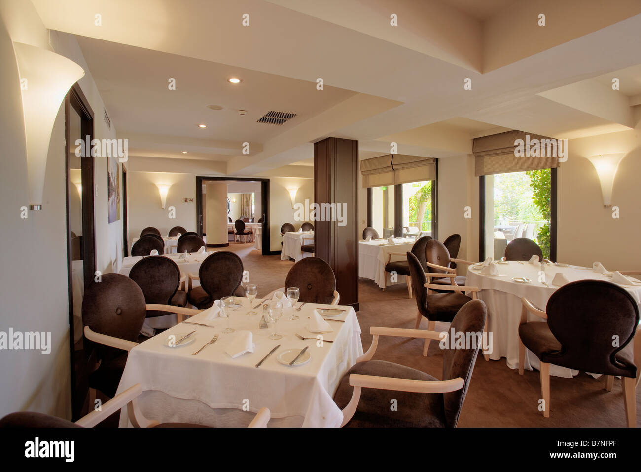 White cloths on tables in modern restaurant in Southern Spain ...