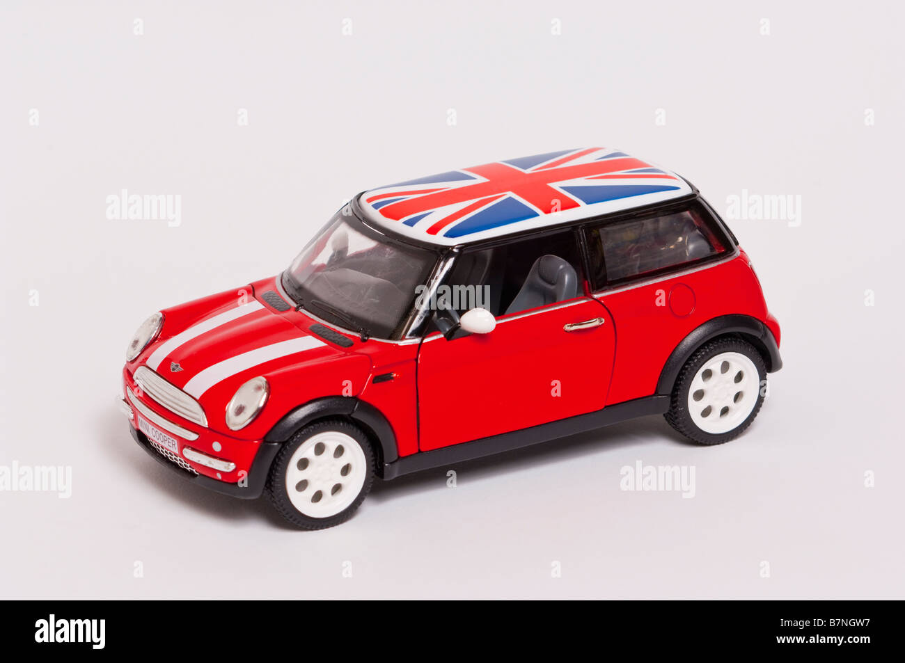 A Close Up Of A Toy Model Mini Cooper Car On A White