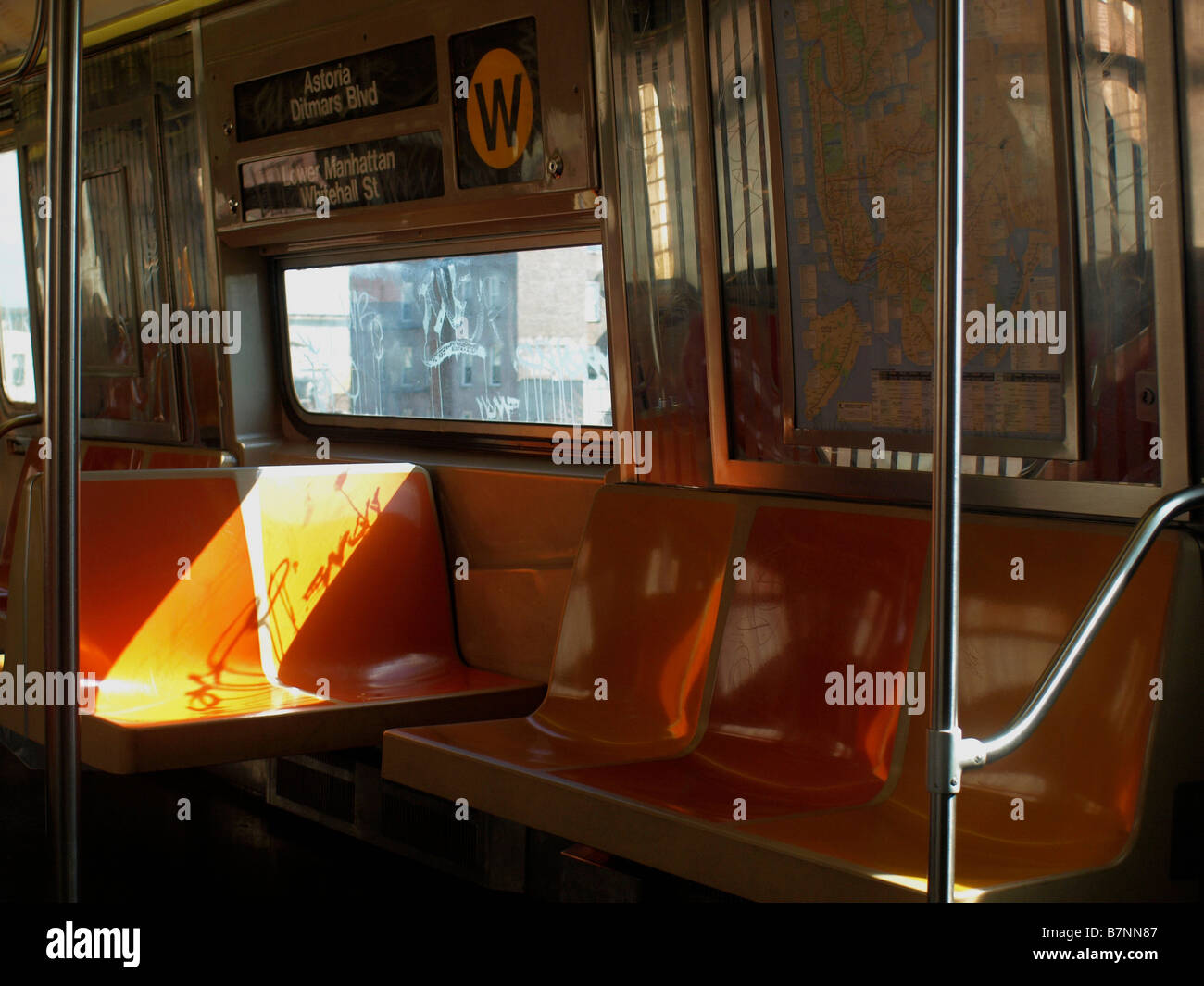 empty seats in a largely empty subway car on the w train line stock photo royalty free image. Black Bedroom Furniture Sets. Home Design Ideas