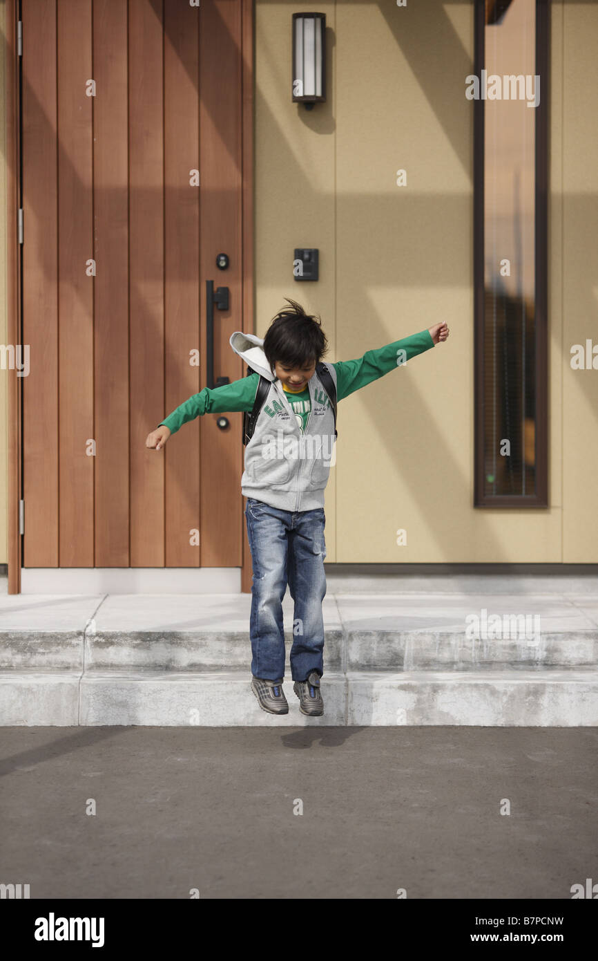 A Boy Going Out Of Front Door Stock Photo: 22005925