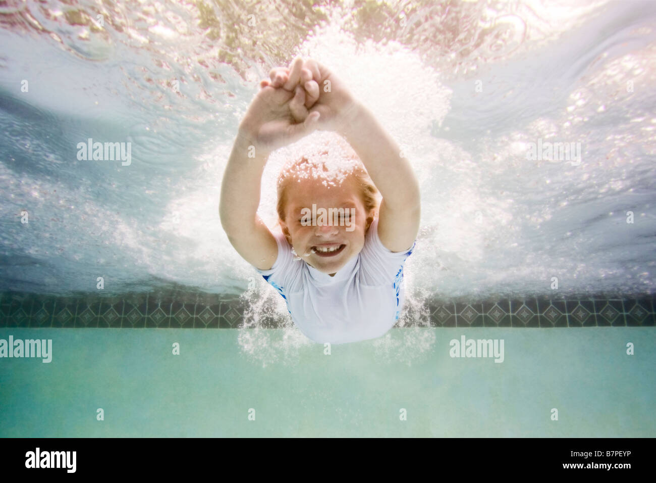 Girl Diving In Swimming Pool Stock Photo Royalty Free Image 22007658 Alamy