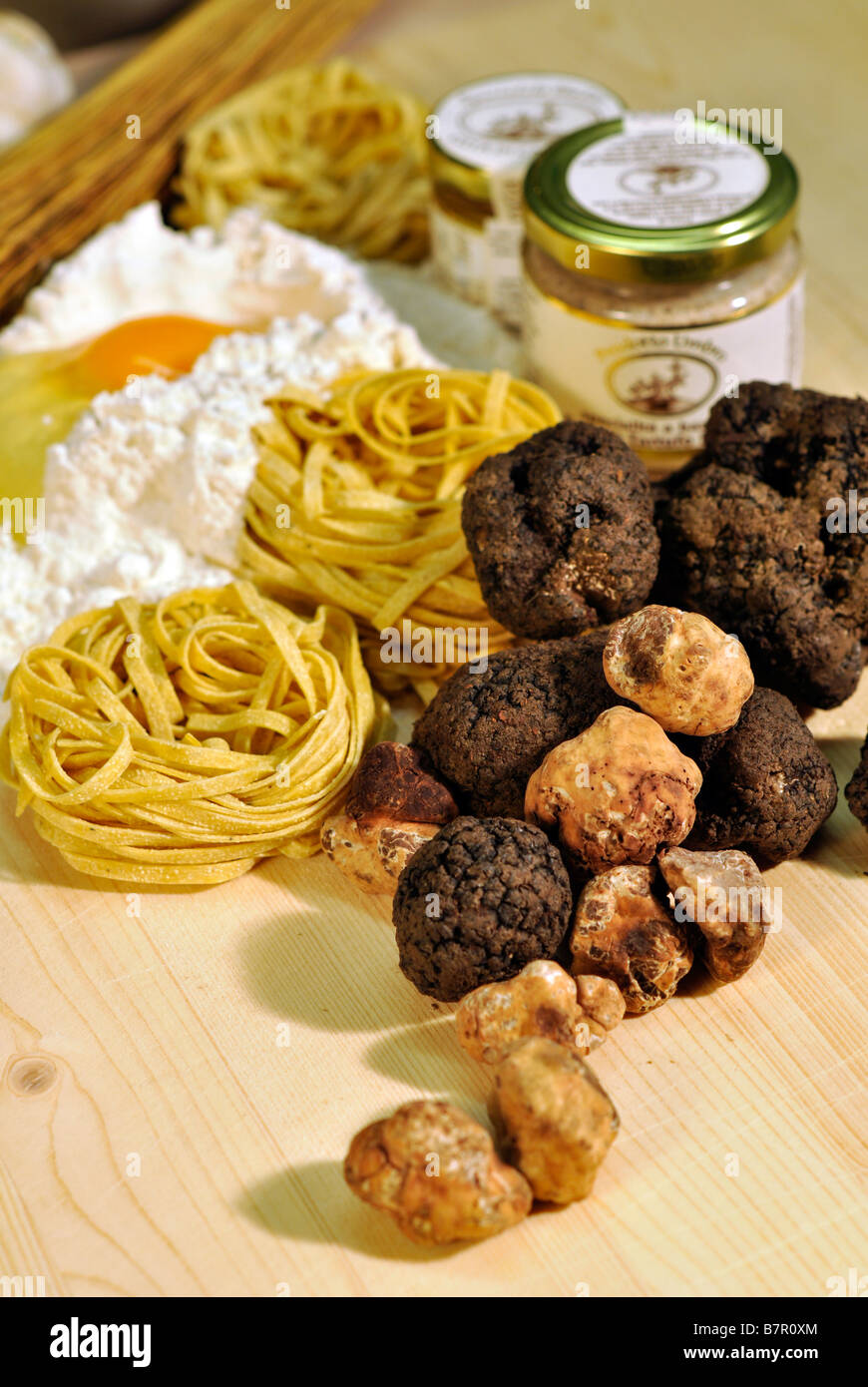 Truffle Butter Pasta fresh black and white truffles with jars of truffle butter and