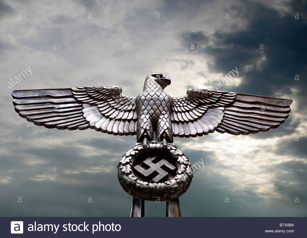 Swastika eagle stock photos swastika eagle stock images alamy nazi eagle sculpture clutching a wreath with a swastika symbol seen against a dark stormy biocorpaavc