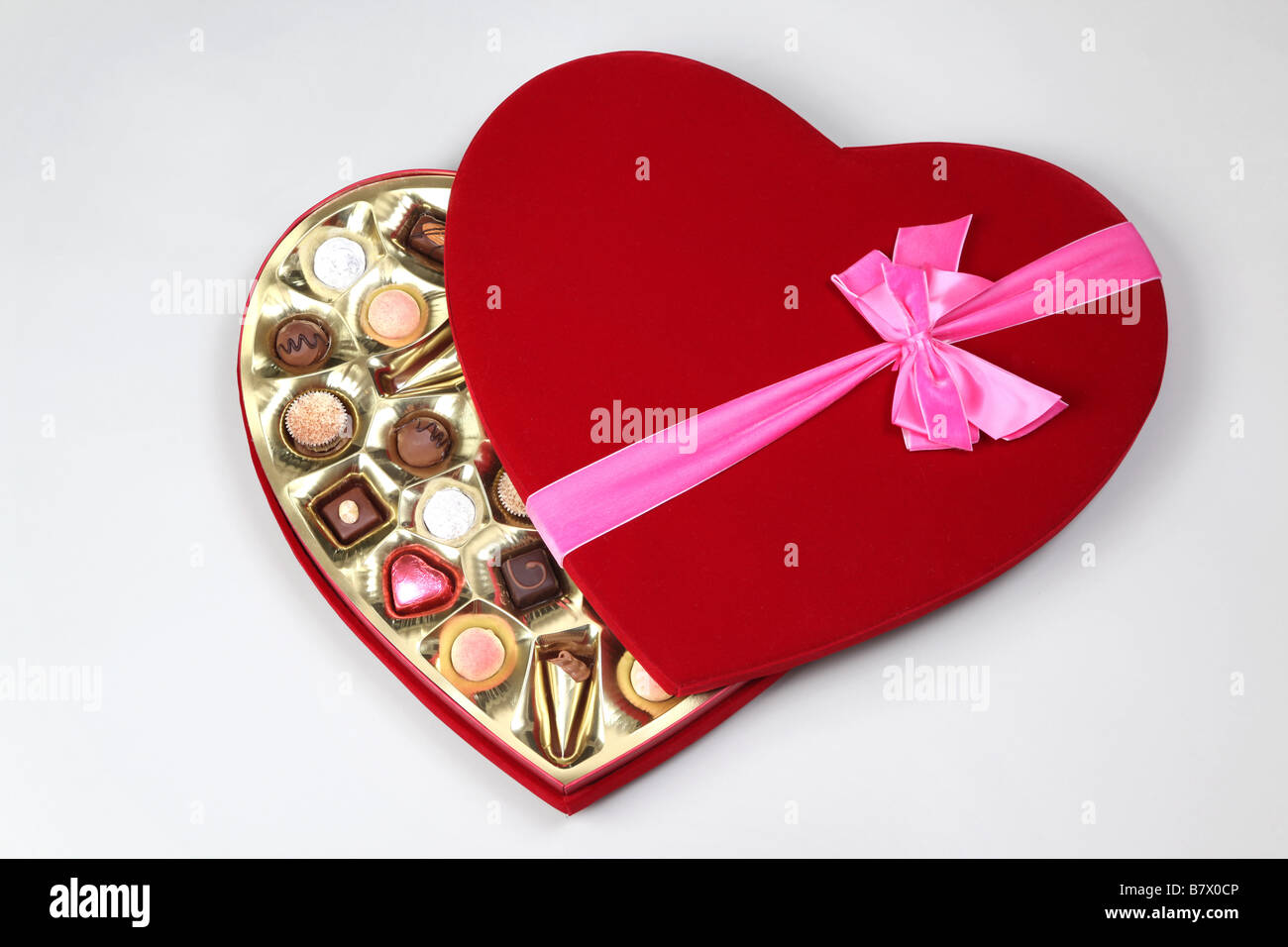Chocolate Heart Shaped Gift Boxes : Heart shaped gift wrapped chocolate box with a pink ribbon