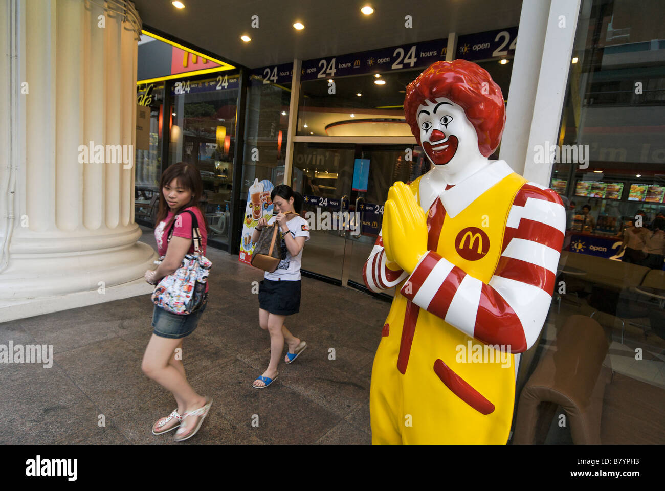 Thai greeting stock photos thai greeting stock images alamy ronald mcdonald doing traditional thai wai greeting at 24hr fast food restaurant pathumwan district in central kristyandbryce Images