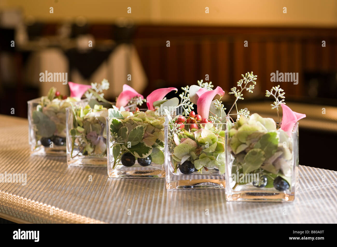 Small glass vases holding a beautiful floral arrangement stock small glass vases holding a beautiful floral arrangement reviewsmspy