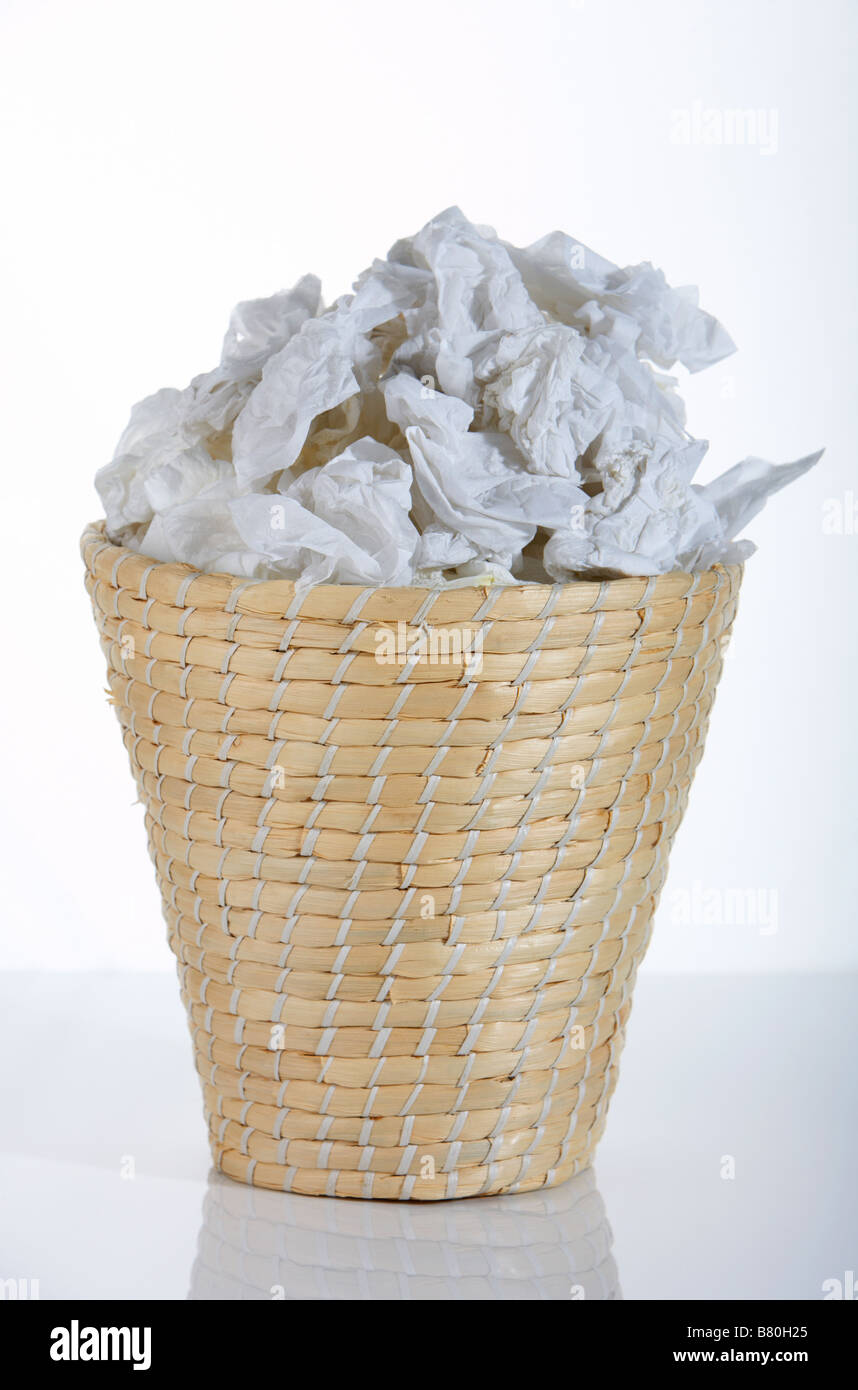 Wicker waste paper basket bin full of used tissues stock photo royalty free image 22141005 alamy - Wicker trash basket ...