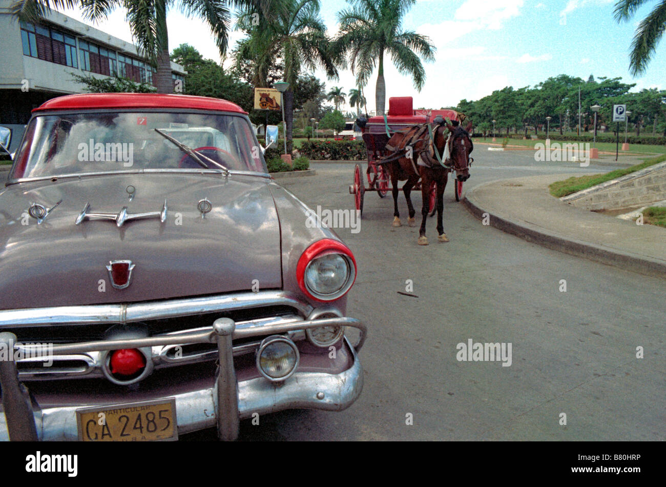 Two common types of transportation in Cuba. An vintage American car ...